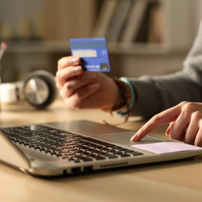 patient using a credit card to pay a bill online.