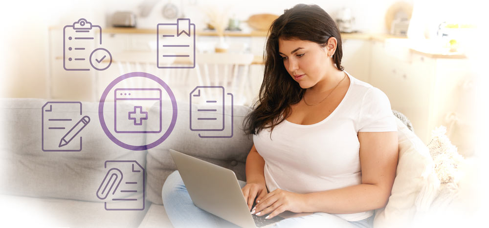 woman filling out forms from home on laptop.